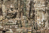 Stone faces on the towers of ancient Bayon Temple in Angkor Thom — Photo