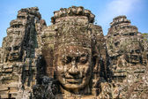 Stone faces on the towers of ancient Bayon Temple in Angkor Thom — Stock Photo