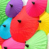 Colorful Thai traditional handmade umbrellas background — Stock Photo