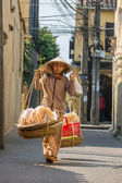 Old woman in Vietnamese clothes — Stock Photo