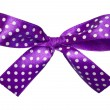 Violet gift satin ribbon bow on white background — Stock Photo