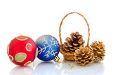 Christmas balls and cones in a basket — Stock Photo