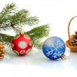 Christmas balls and cones in a basket — Stockfoto