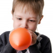 Portrait of a little boy, which inflates the balloon isolated on — Stock Photo #16232657