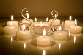 Candles in the shape of a heart with swans — Stock Photo