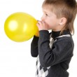 Portrait of a little boy, which inflates the balloon isolated on — Stock Photo #16300763