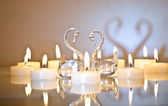 Candles in the shape of a heart with swans — Stock fotografie