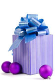 Christmas gift with Purple Ball and ribbon bow isolated on white — Stock Photo