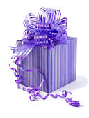 Purple gift box with a ribbon bow — Stock Photo