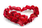 Rose petals in a shape of a heart — Stock Photo