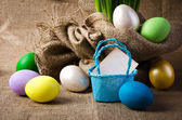 Colorful easter eggs  on burlap — Stock Photo