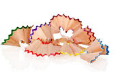 Beautiful shavings from colored pencils isolated on white backgr — Stock Photo