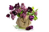 Beautiful bouquet of tulips with sprigs of lilac in a vase isola — Stock Photo