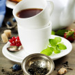 Tea with mint and berries — Stock Photo