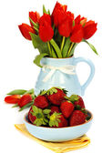 Strawberry and bouquet flowers — Stock Photo
