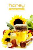 Honey and flowers — Stock Photo