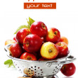 Fresh red apples in metal colander — Stockfoto