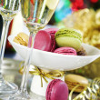 Colorful macaroons and Champagne - Stock Photo
