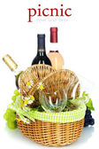 Picnic basket with wine and grape — Stock Photo