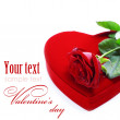 Red box in heart shape and rose - Stock Photo