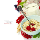 Healthy breakfast with bowl of oat flakes — Stock Photo