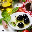 Olives and Olive Oil on an old tablel — Stok fotoğraf