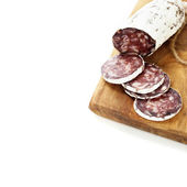 Traditional sliced meat sausage salami on wooden board — ストック写真