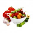 Assorted tomatoes and vegetables in colander — Stock Photo #25925919