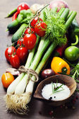 Fresh spring onions and vegetables — Stock Photo