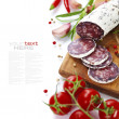Traditional sliced meat sausage salami on wooden board — Stok Fotoğraf #26573173