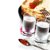 Russian vodka with pancakes and red caviar — Stock Photo