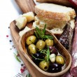 Italian salami with olives and ciabatta  — Stock Photo