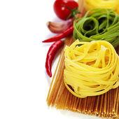 Whole wheat spaghetti and egg pasta nests — Stock Photo