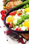 Fried eggs with fresh vegetables — Stock Photo