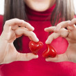 Red hearts in hands - St. Valentine concept — Stock Photo #33705413
