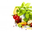 Fresh basil in the pot and italian ingredients — Stock Photo