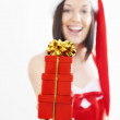 Beautiful young woman with Christmas present — Stock Photo #33705887