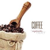 Kávová zrna v pytli — Stock fotografie
