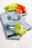 Healthy food - water, carrot and lettuce — Stock Photo