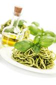 Delicious italian pasta with pesto sauce — Stock Photo