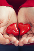 Red hearts in hands - St. Valentine concept — Stock Photo