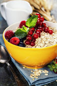 Breakfast with oats and berries — Stock Photo
