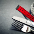 Measuring tape, knife and fork — Stock Photo #44117297
