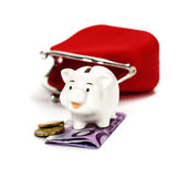 Pink piggy bank and red purse — Stock Photo