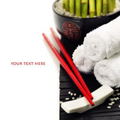 Chopsticks and a lucky bamboo plant — Stock Photo