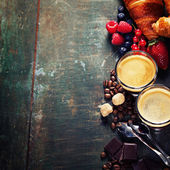 Coffee with croissants and berries — Stock Photo