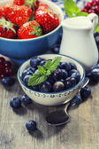 Berries in bowls  on Wooden Background. — Stock Photo