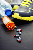 Different tools for sport and pills — Stock Photo