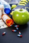 Different tools for sport and pills — Stockfoto