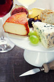 Wine and cheese plate — Stock Photo